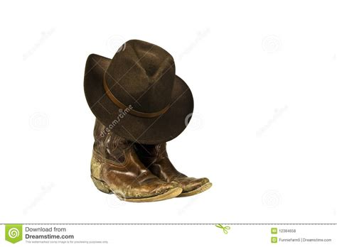 dirty cowboy boots and hat isolated royalty free stock