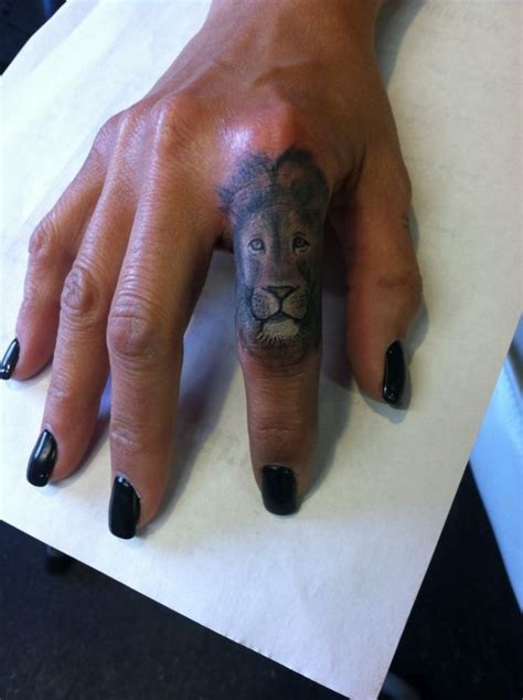 lion tattoo on finger 18 impressive tattoos for fingers