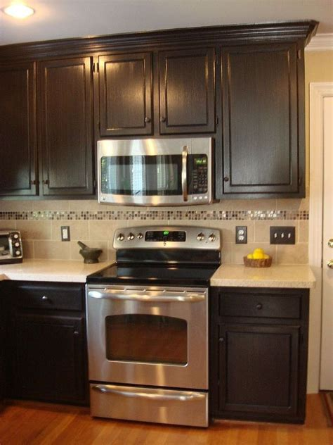 dark colored cabinets in kitchen 25 best ideas about brown painted cabinets on pinterest