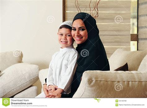 mom son couch arabic family mother and son sitting on the couch in