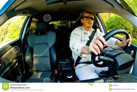 man driving car stock photo image   glasses