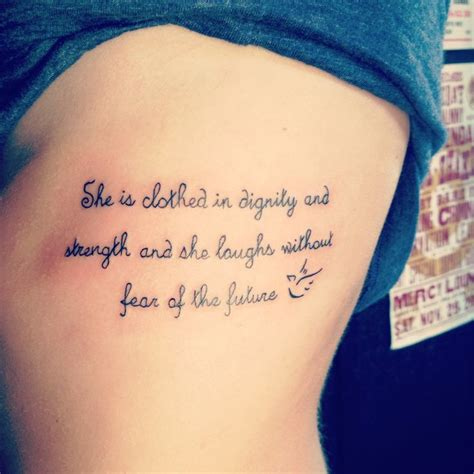 she is clothed in strength and dignity tattoo rib she is clothed in dignity and strength and she