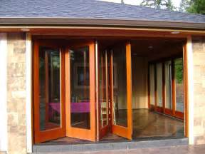 Glass Doors Exterior Small Dining Room Minimalist House Design With Bi Fold Glass Exterior Doors With Brown Wooden