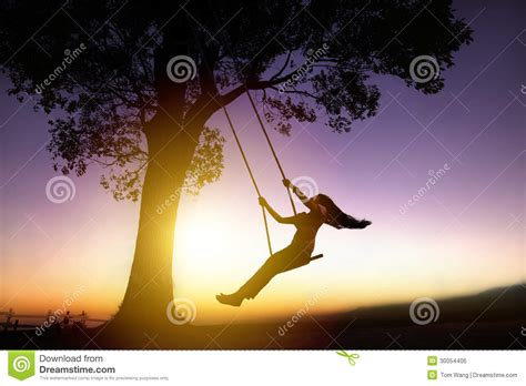 woman on a swing silhouette of happy young woman on swing royalty free