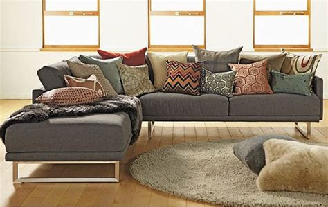 how to place pillows on a sectional tufted round ottoman living room contemporary with ballard