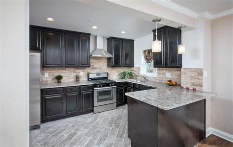 light and dark kitchen cabinets chocolate cabinets with light granite counters savae org