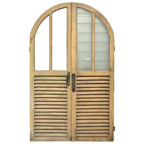 English Victorian Arched Double Doors With Glass And Louvered Glass Doors