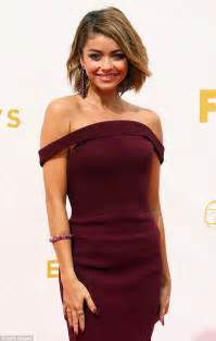 Sarah hyland attends the emmy awards 2015 wearing a wine coloured gown