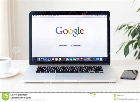 google home in russian macbook pro retina with google home page on the screen