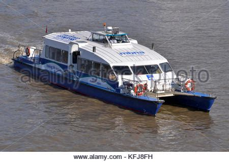 thames clipper bus a thames clipper river bus boat travelling on the river