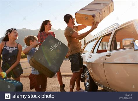 loading bike onto roof rack car roof rack stock photos car roof rack stock images