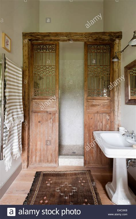 Wooden Shower Doors A Pair Of Wooden Doors Used As A Shower Screen In Stock Photo Royalty Free Image