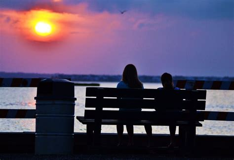 two people sitting on a bench sitting on a bench by skipo84 on deviantart