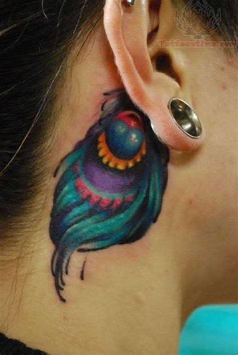 tattoo cover up ideas behind ear 25 colorful peacock feather tattoos