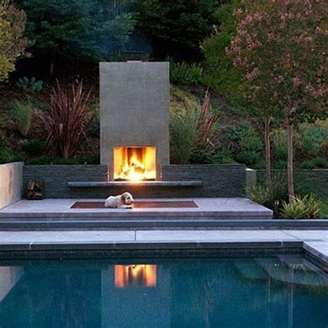outdoor fireplace by the pool home