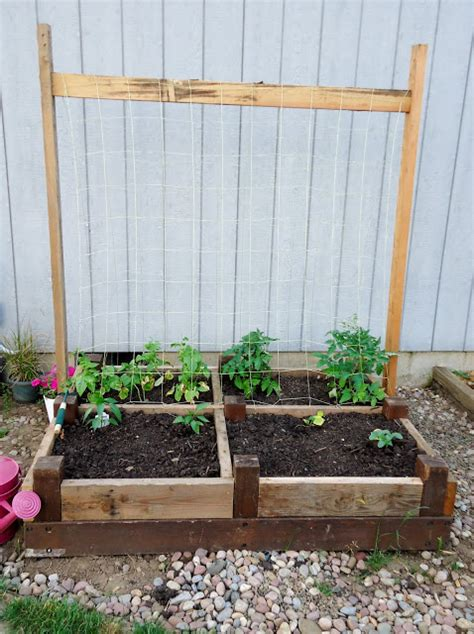 repurposed bed frame old bed frame repurposed as a raised garden bed hometalk