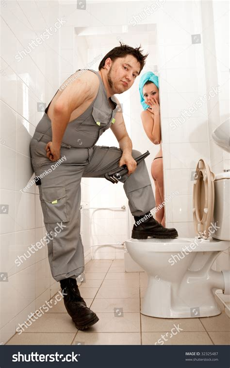 naked girls in a bathroom royalty free angry plumber with the adjustable 32325487