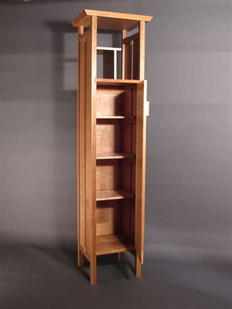 tall narrow armoire cabinet  linen closet entry