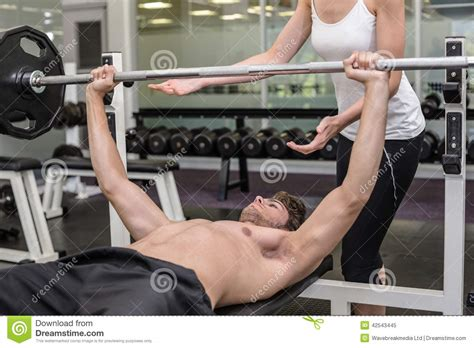 Fits Power Lifting Fitness Lifting Fitness fit shirtless lifting barbell with his trainer