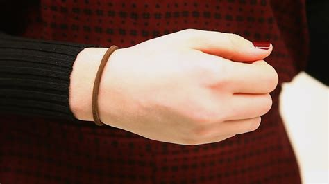 your wrists to your arms and now to your hair scuncis hair wearing a hairband on your wrist you may be more