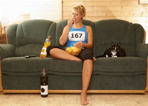 couch to runner runner eating chips on sofa stock photo getty images
