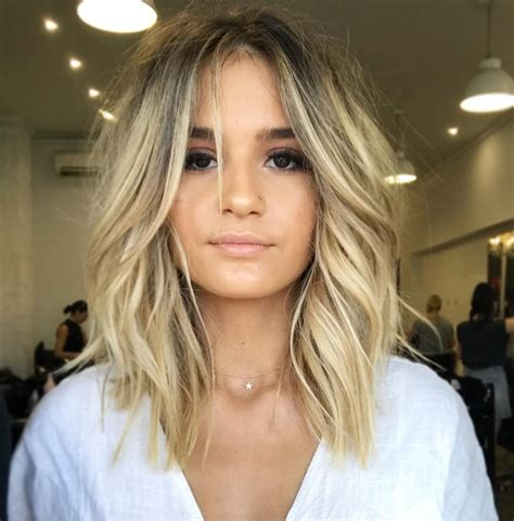 Women's Blonde Curtain Banged Lob with Soft Undone Textured Waves and Dark Ash Shadow Roots