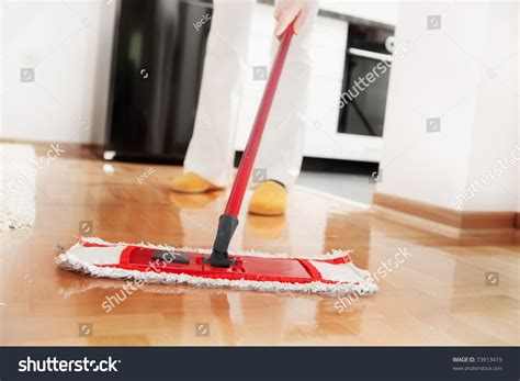 house cleaning music house cleaning mopping hardwood floor stock photo 73913419 shutterstock
