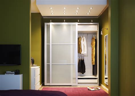 bedroom walk in closet with traditional and modern