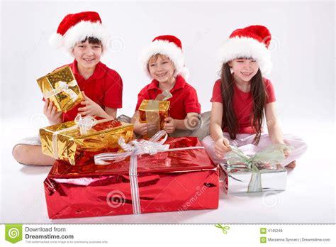 Kids Opening Christmas Gifts Stock Photo - Image: 4145246 Happy Kids Opening Christmas Presents