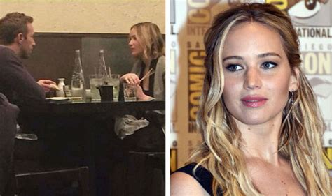 chris martin and jennifer lawrence jennifer lawrence jokes she s expecting chris martin s