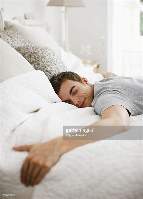 laying on bed happy man laying on bed stock photo getty images