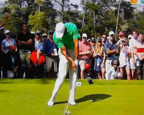iron swing slow motion tiger woods golf swing video 2012 face on view
