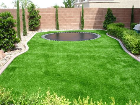 trampoline surrounded  sythetic turf traditional