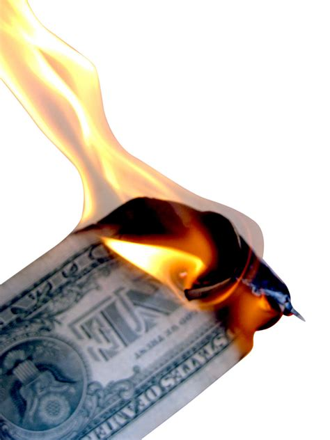 new year money burning burning money isolated on white an image of a 1 dollar
