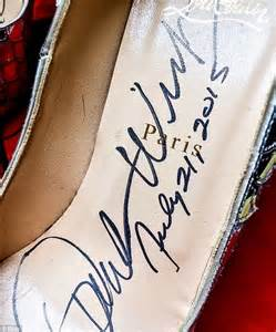oprah winfrey signature oprah s autographed louboutin heels sell for almost