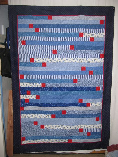 judy s jelly roll race 1600 quilt with added squares
