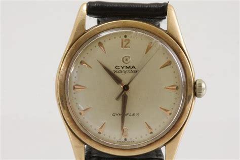 a gold gents cyma wristwatch jewellery philips