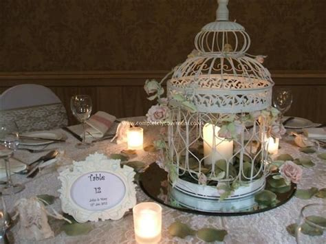 candles flowers mirror tray birdcage keilah and