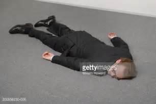 wearing suit lying on floor stock