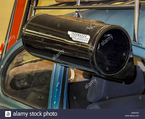 automobile window mounted evaporative air cooler a thermador car cooler from 1950 is displayed on a classic