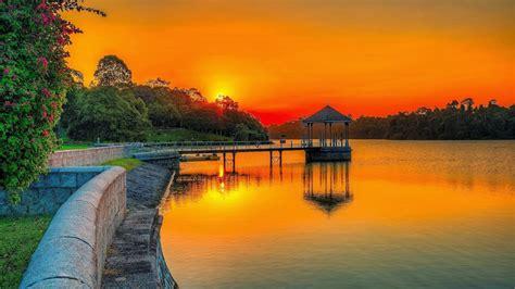 sunset orange sky lake park wooden platform summer garden
