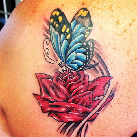 butterfly on rose tattoo butterfly tattoos pictures to pin on