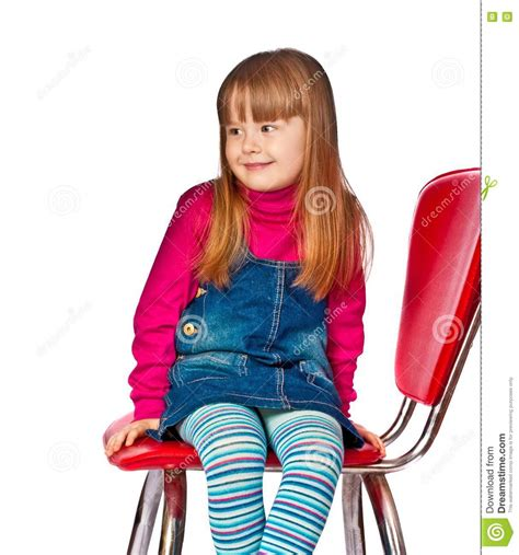 little girl on chair portrait of beautiful little girl sitting on chair royalty
