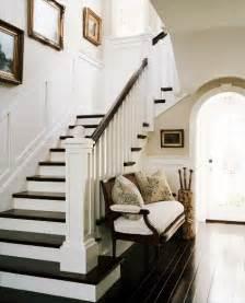 Basement Vastu - black and white stairs with wood floors