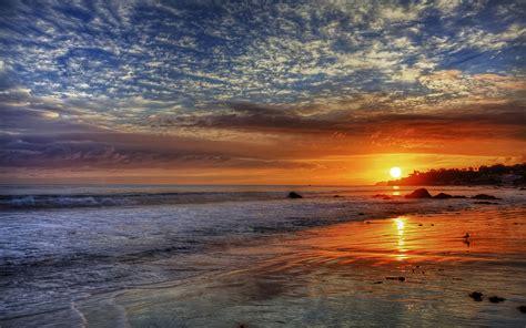 sunset red sky clouds sea waves sandy beach  malibu