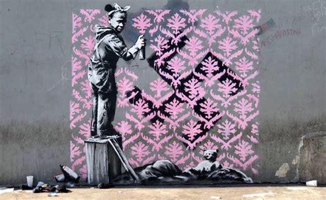 banksy murals   paris  coincide  world