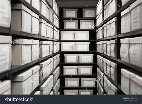 file room storage archive depository room black shelves with white office boxes card file cabinet evidence