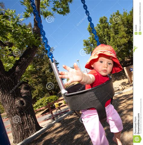 swing a little more girl ona swing royalty free stock photos image 9548928