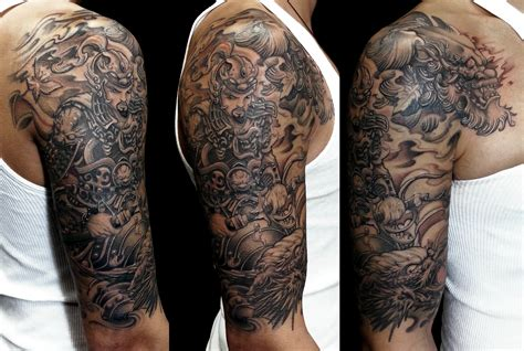 dragon sleeve tattoo black and grey images half sleeve warrior dragon and foo dog tattoo chronic ink