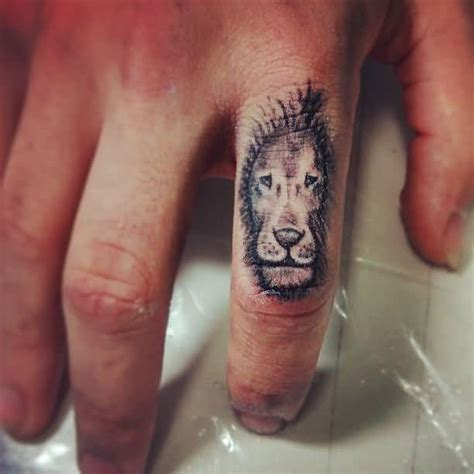 lion tattoo on finger design on finger tattooshunter
